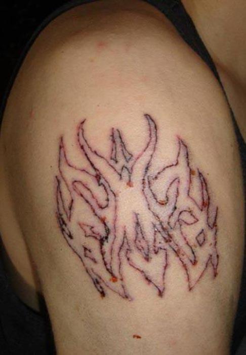 Ίσως ο χειρότερος τατουατζής του κόσμου... (11)