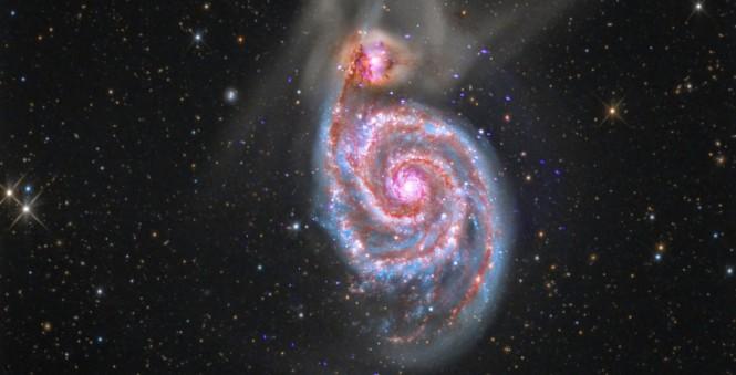 Γαλαξίας καταβροχθίζει έναν άλλο γαλαξία   Φωτογραφία της ημέρας