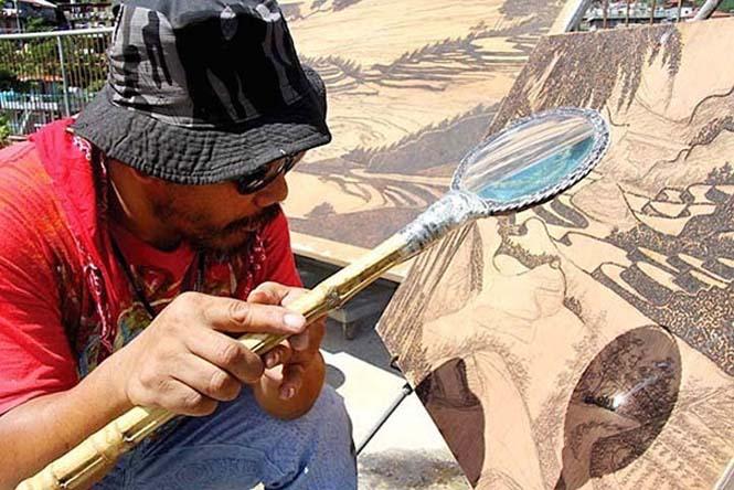 Καλλιτέχνης δημιουργεί απίστευτα έργα τέχνης με το φως του ήλιου και έναν μεγεθυντικό φακό (2)